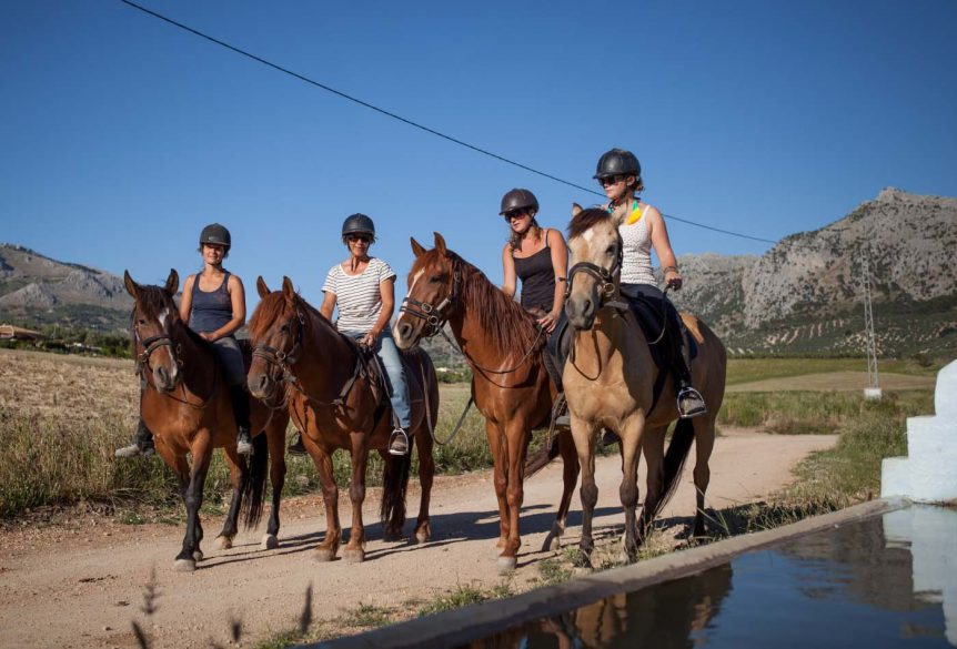 bitless horse riding in mountain scenery in Spain